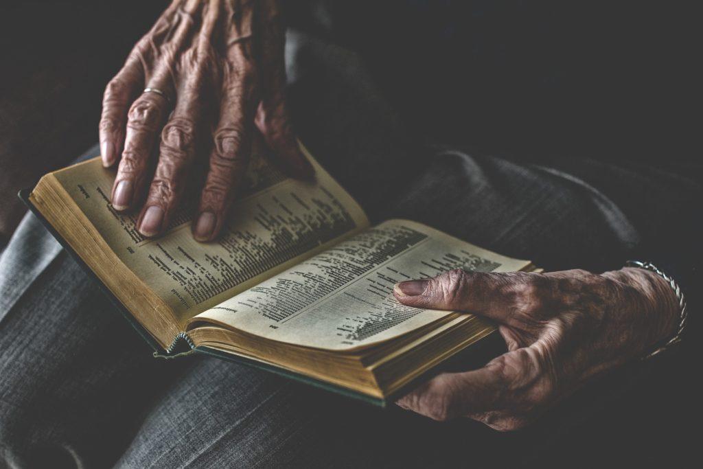 https://pixabay.com/photos/book-human-adults-literature-hand-4001398/